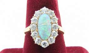 Opal, diamond, and 14k yellow gold ring