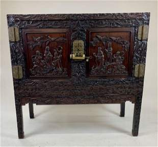 Chinese hardwood carved two door cabinet