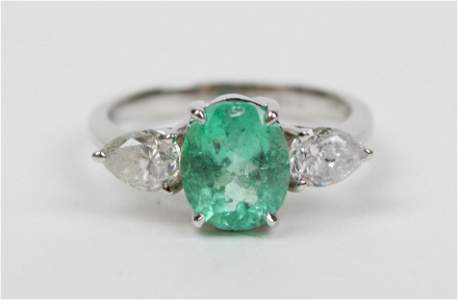 Emerald, diamond, & 18k white gold ladies ring