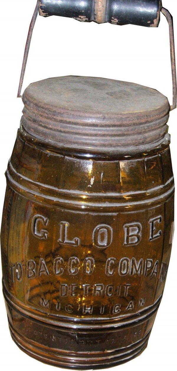 15: Globe light amber glass tobacco jar w/ bail top lid