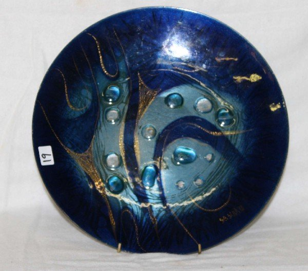 19: 12 inch round enamel on copper plate signed Sacha B