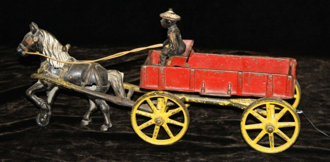 5: Kenton 15 inch cast iron horse and wagon with Africa