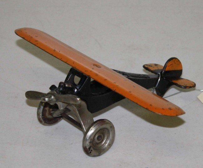 7: Arcade 8 inch The Monocoupe cast iron airplane