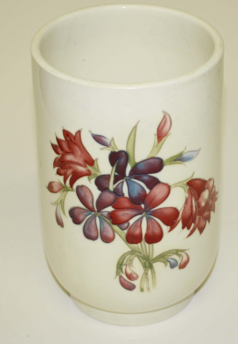 6: Moorcroft 9 ½ inch floral vase with crème background
