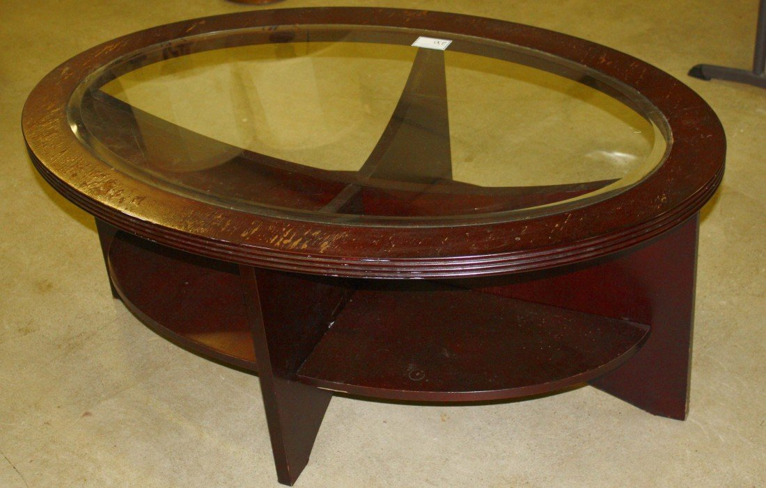 230: Modern oval beveled glass top coffee table