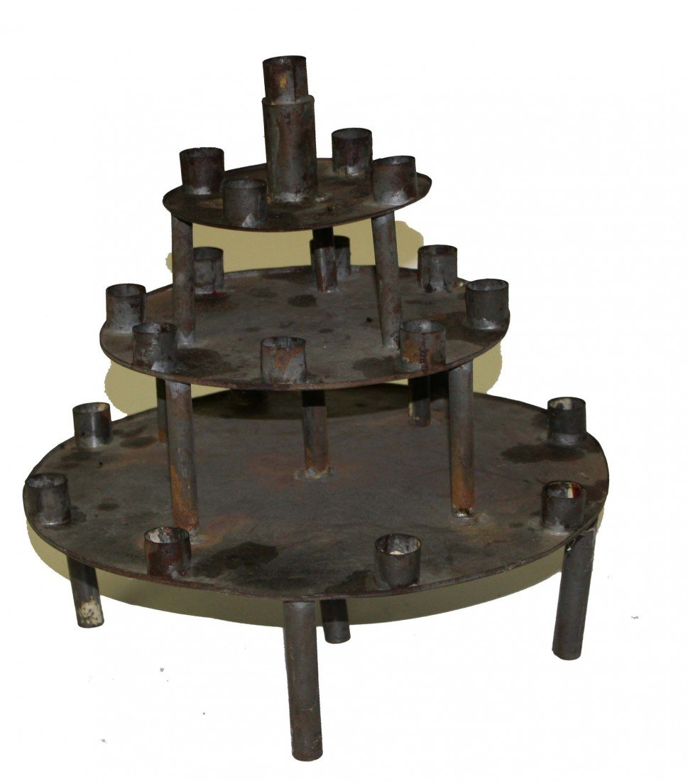 23: early tin multi light 3-tiered candle holder