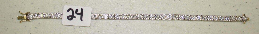 24: 14 k gold and diamond tennis bracelet with 38 round
