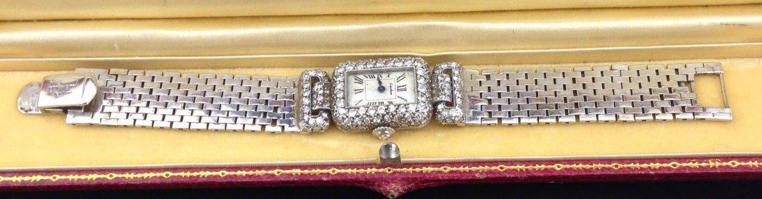 Outstanding Art Deco signed Cartier Demoiselle 14k w.g.