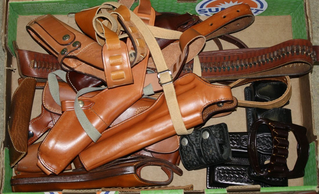 Lot of Leather holsters, slings, scabbards and