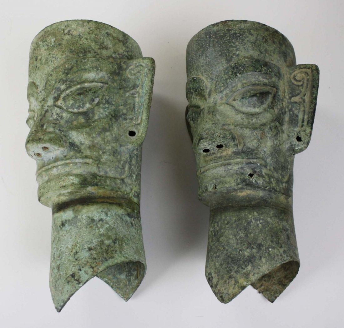 Sanxingdui bronze heads, two pieces. 2000-771 B.C.