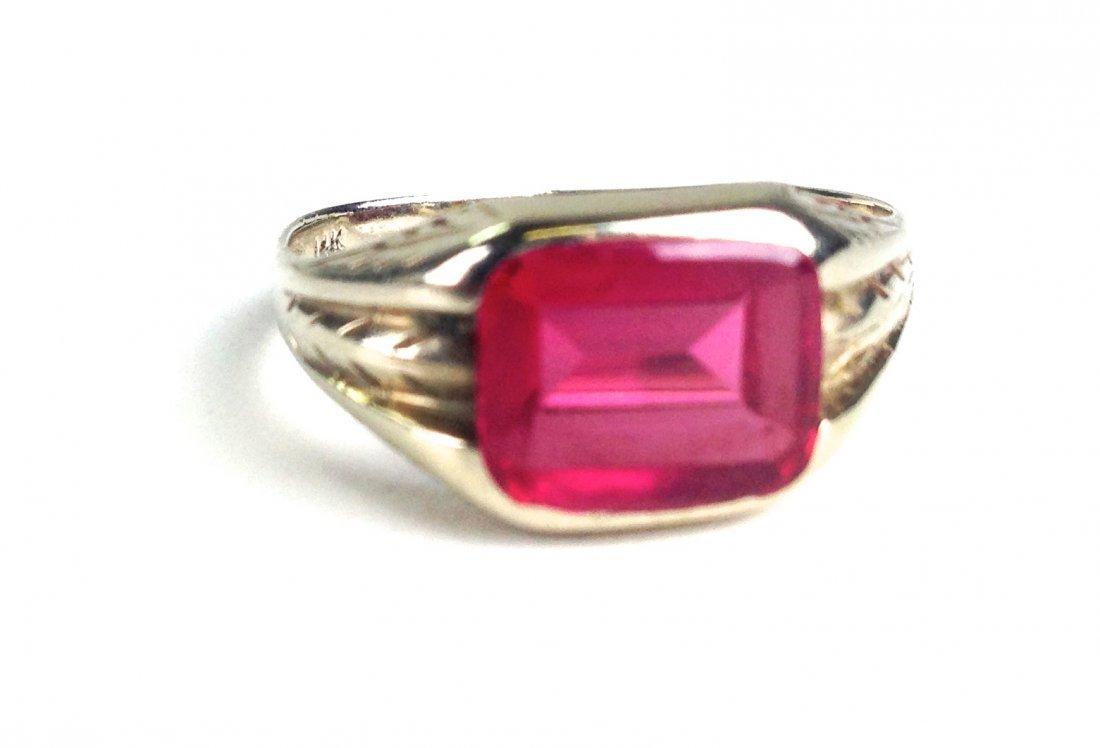 Men's 14k white gold ring having a polished natural