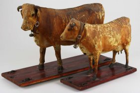 2 Late 19th C Wood & Composition Cow Pull Toys On Grain