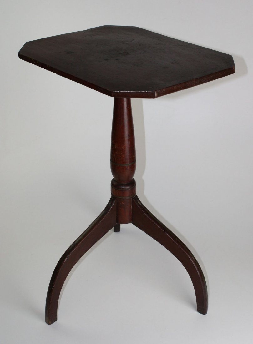 New England spider leg candle stand in old red surface