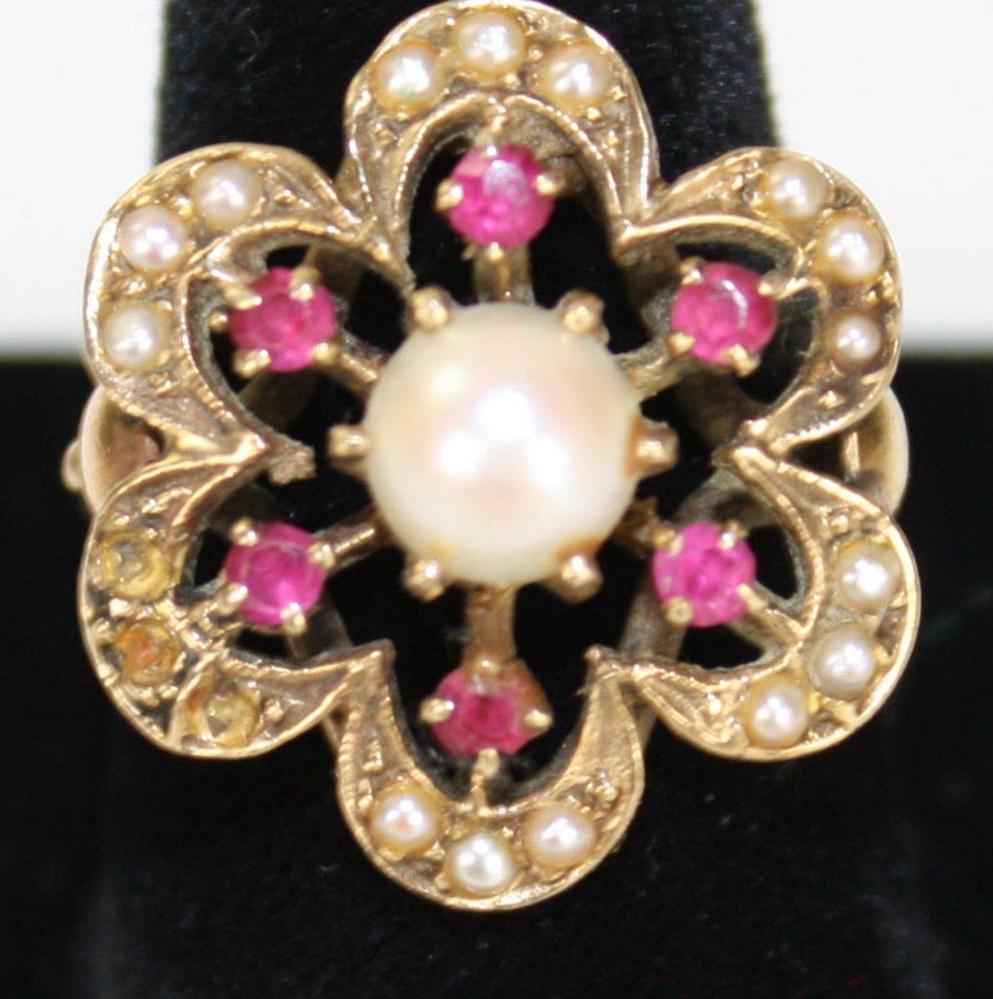 14k y.g. floral form ladies ring having center 7mm