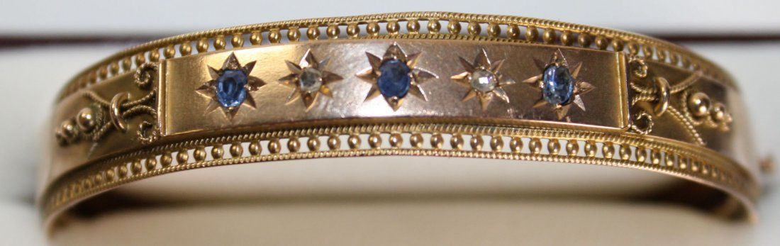 Victorian 10k yellow gold bangle having 2 old mm cut rd
