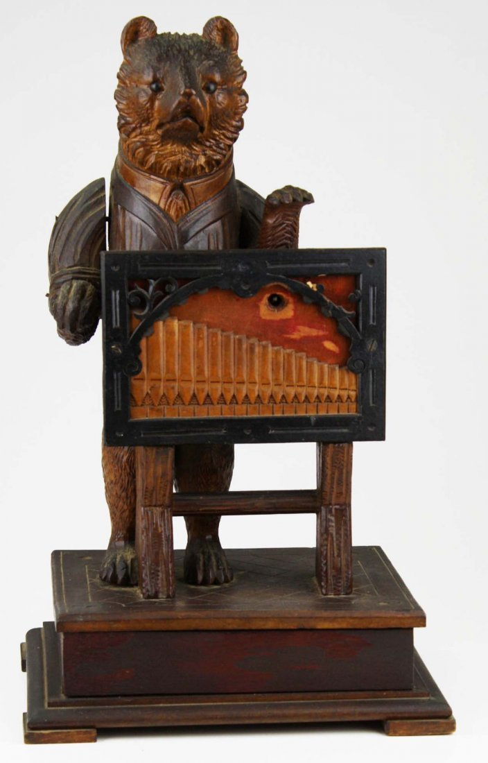 American carved bear coin operated music box, glass