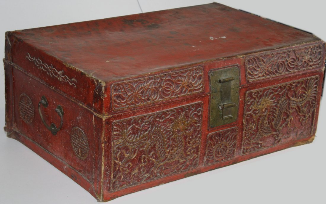 19th century red leather Chinese trunk with impressed 4