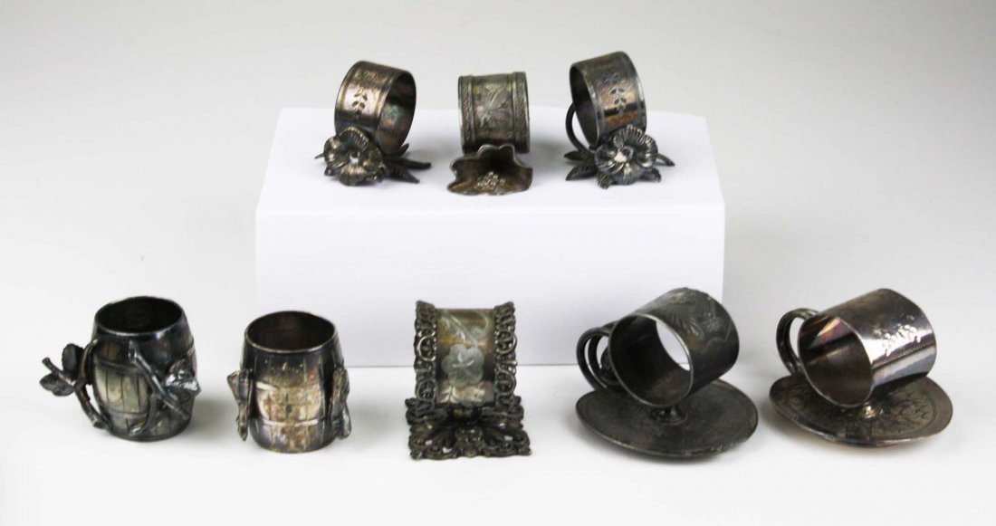 lot of 8 silver plated napkin rings incl; floral, lily