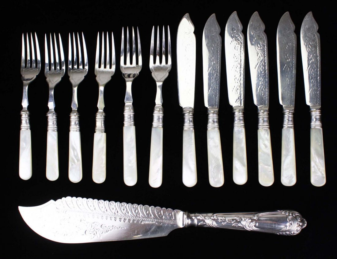 ornate silverplated fish slice and 12 mother of pearl