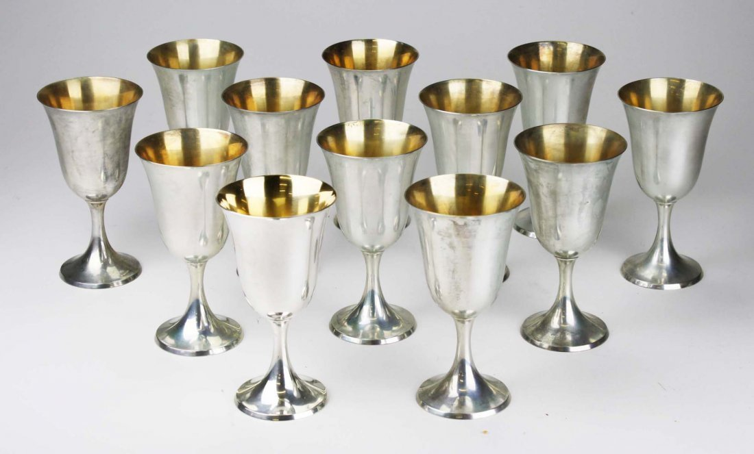 Set of 12 Wallace sterling water goblets with vermeil