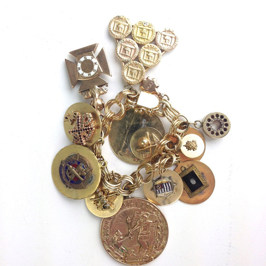 14k yellow gold charm bracelet with various 14 various