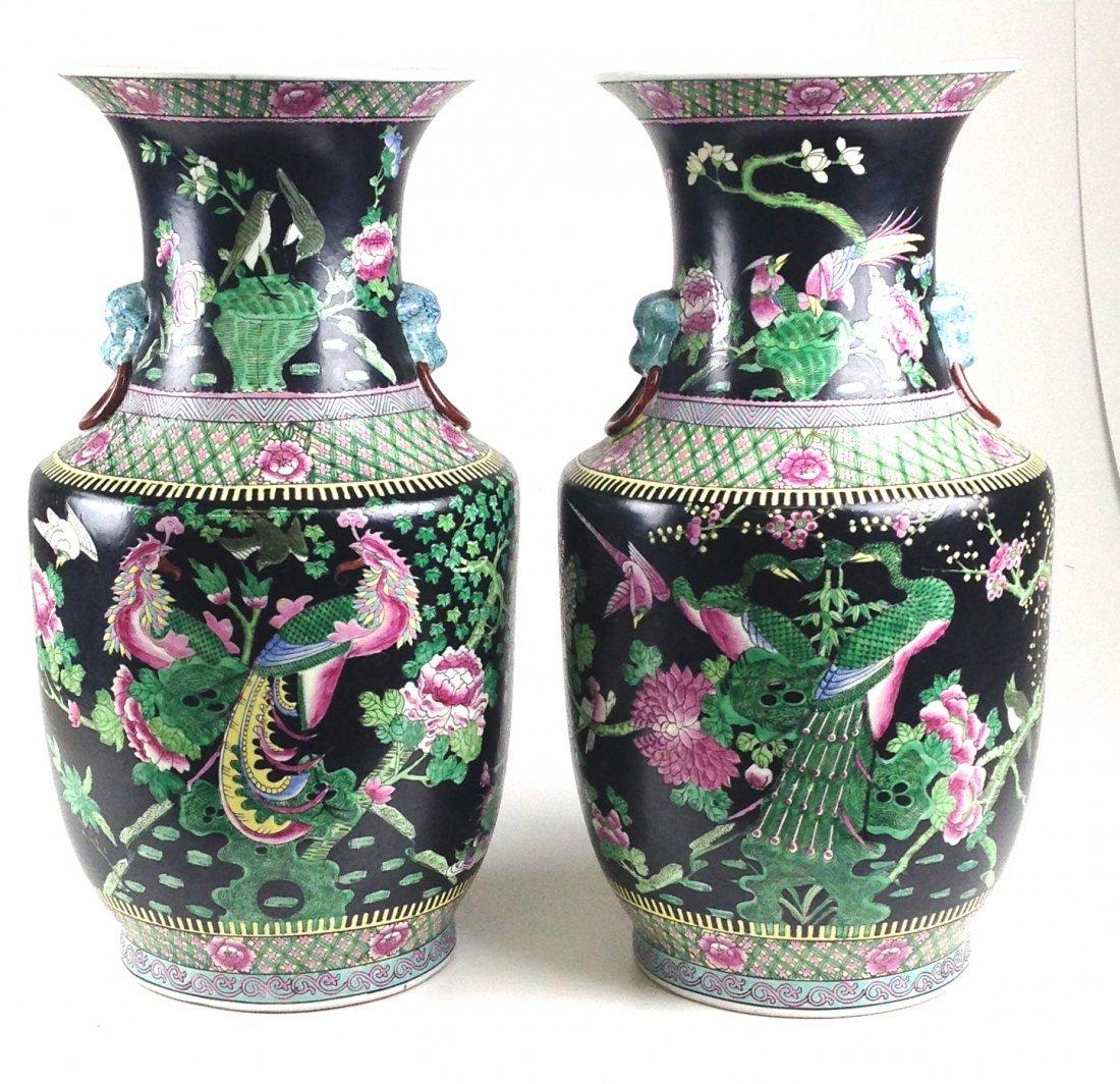 Pair of Chinese porcelain vases of black enamel field