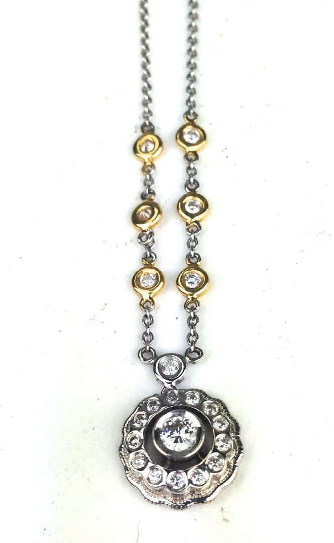18 k white gold pendant & chain, pendant with .2ct rd.