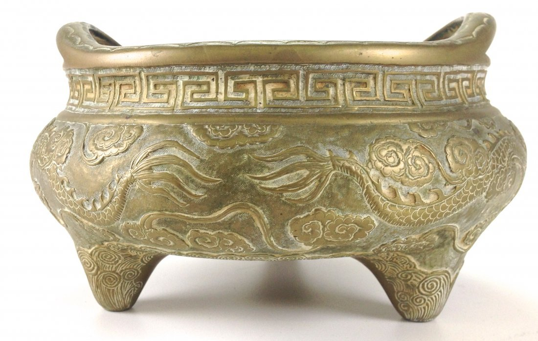 Chinese bronze dragon decorated footed low incense