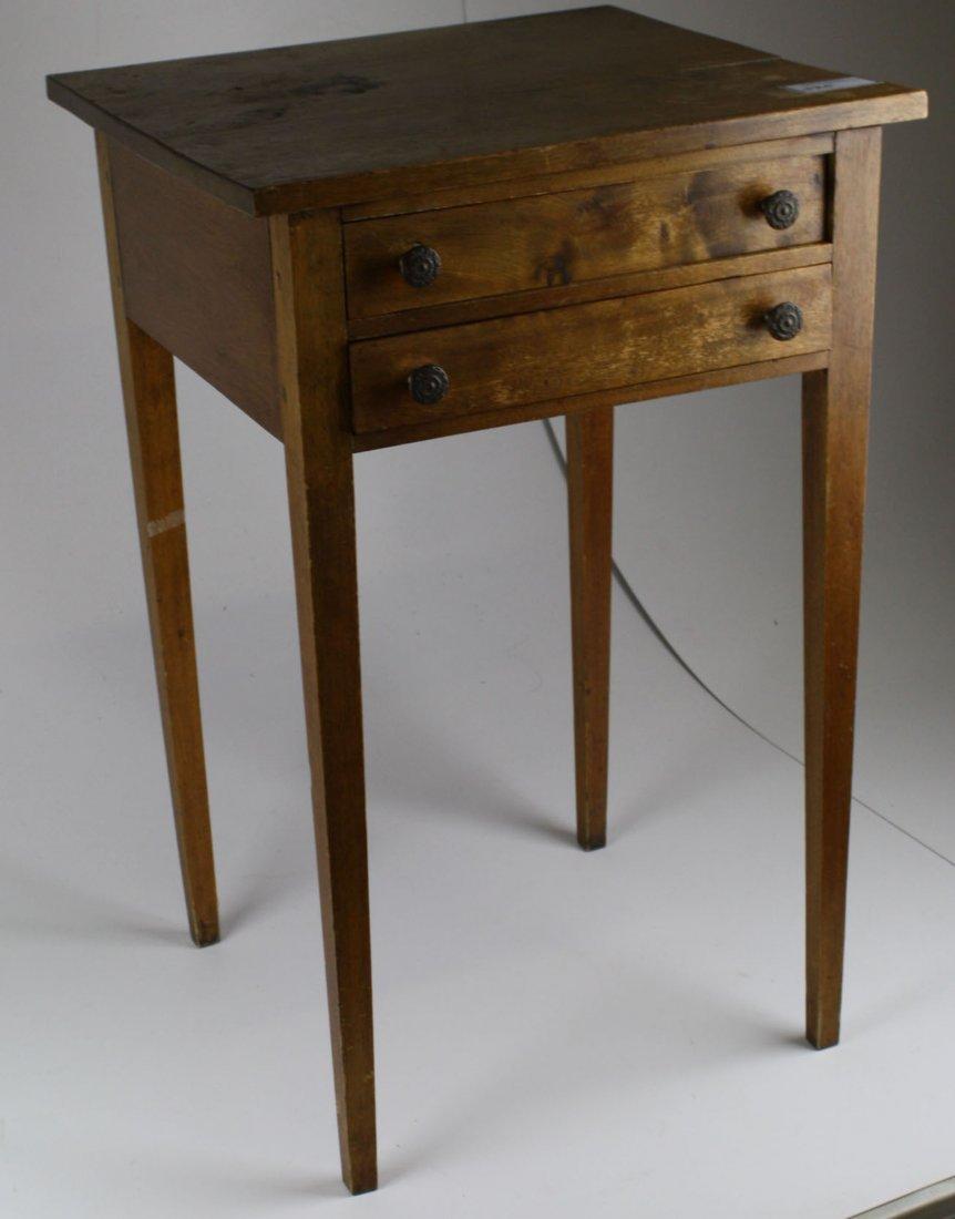 Hepplewhite birch two drawer tapered leg stand.