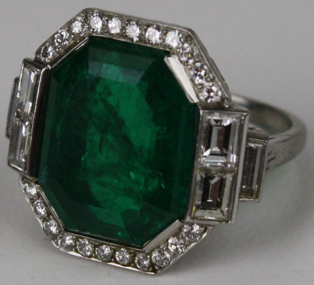 Platinum Art Deco step cut natural emerald ring