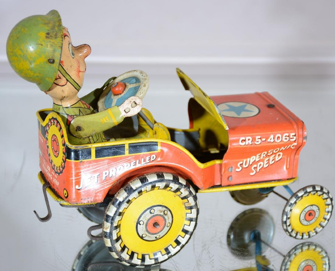 GI Joe Jouncing Jeep Wind Up Tin Toy