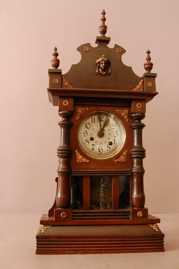 100: Geman Musical Mantel Clock.  Brass Applied Victori