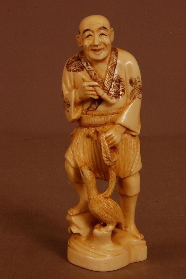 11: Carved Ivory Figure