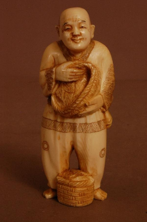 12: Carved Ivory Figure