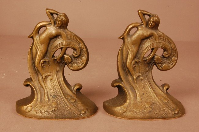 11: Pair of Art Noveau style cast iron bookends.  Stand