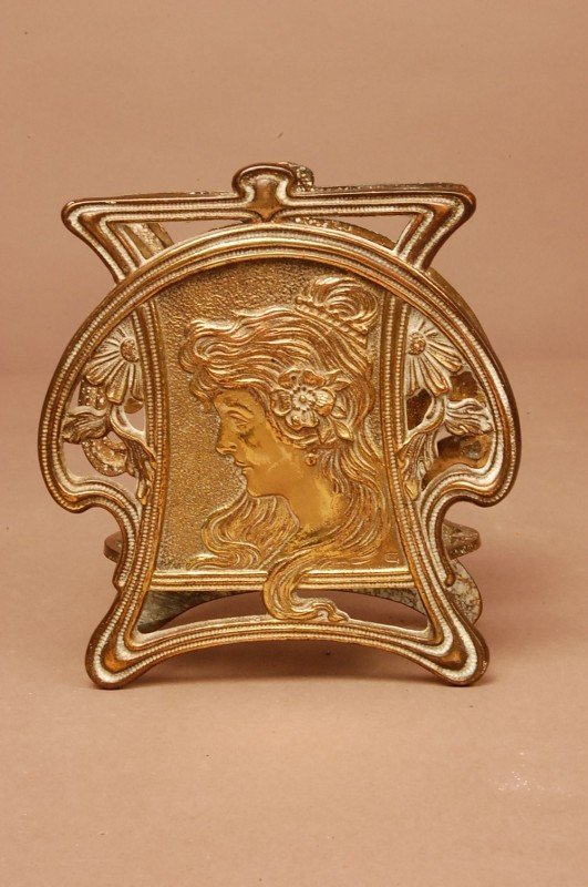 12: Art Noveau Napkin holder.  Brass with embossed face