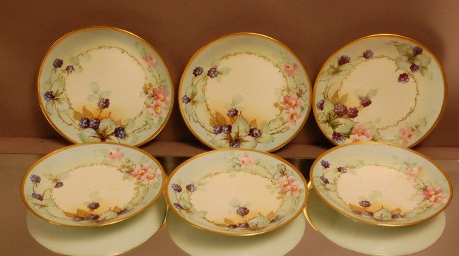 10: Set of 6 Limoges plates.  Floral Decorated.  Signed