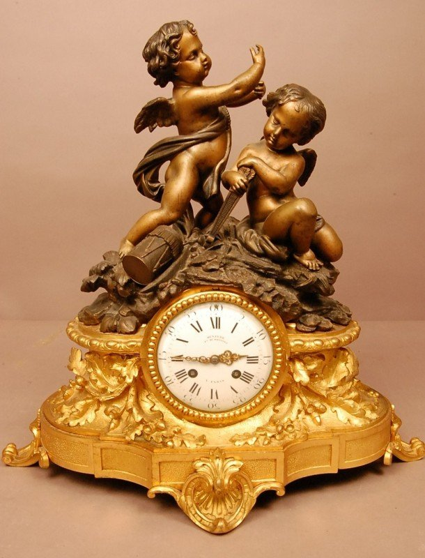80: French Louis XV style Bronze mantel clock with 2 ch