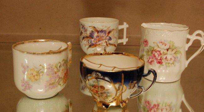 18: 4 porcelain decorated mustache cups.  Ca. 1900