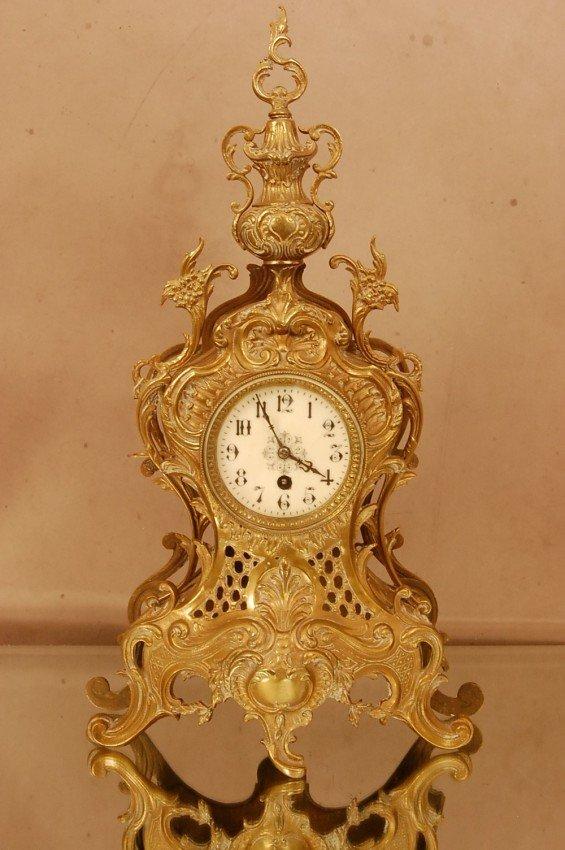 23: French Bronze Louis XV style mantel clock.  Porcela