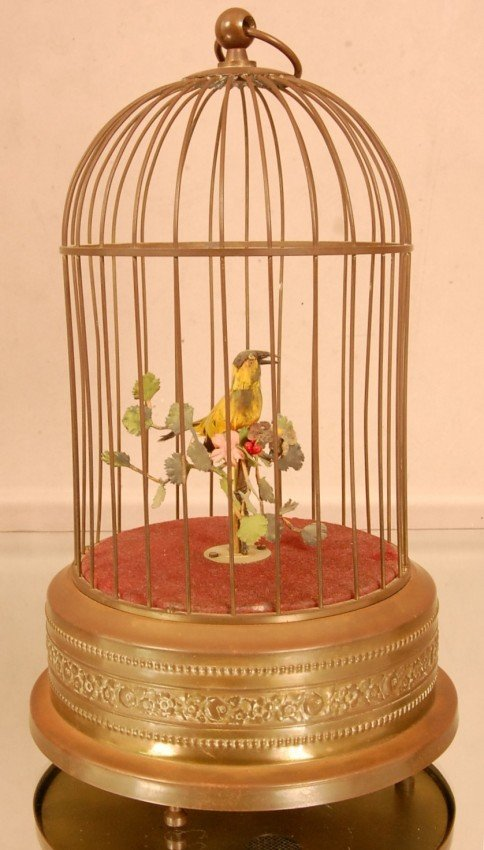 24: Automatic Singing Bird in Brass Cage.  With Swiss M
