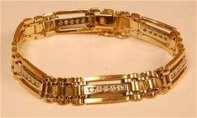 217: Mans 14 K yellow and white gold and diamond link b