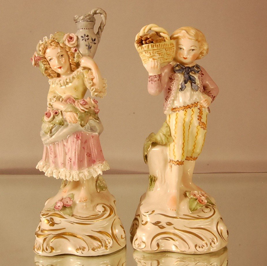 12: Pair of Decorated Porcelain Statues.  French boy wi