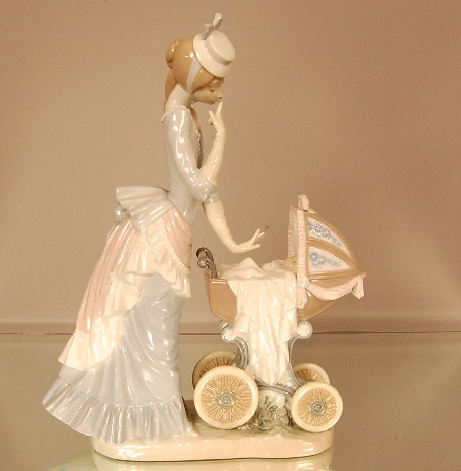 19: Llardo Porcelain figure of lady with baby carriage.