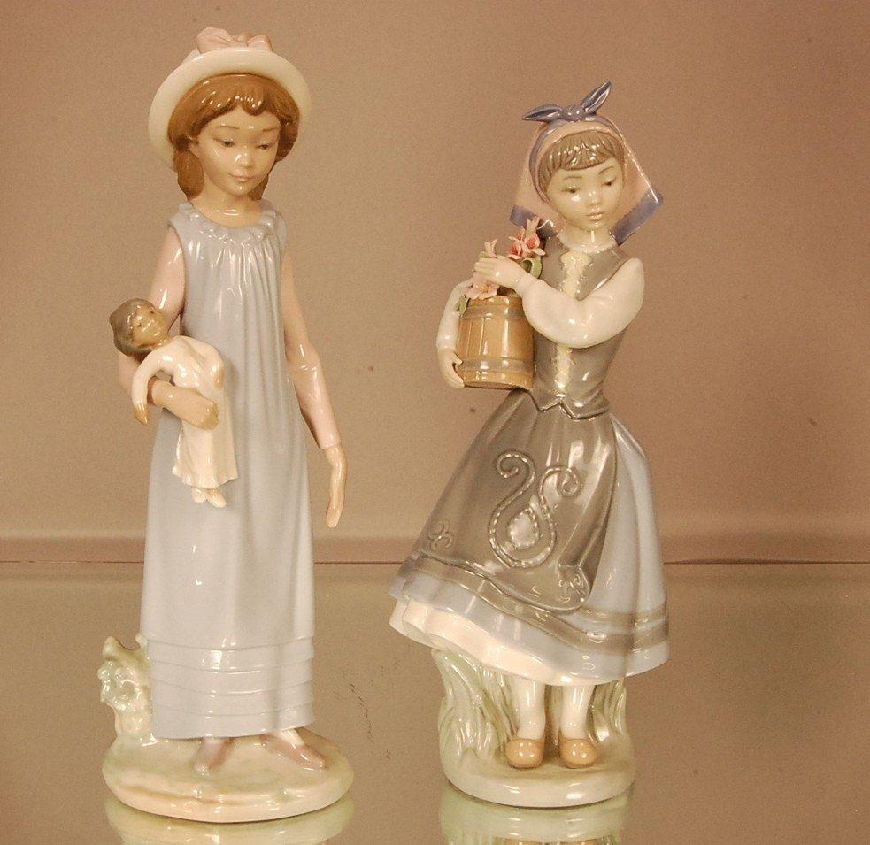 "20: 2 Llardo Porcelain figures.  Girl with doll 11"" t x"