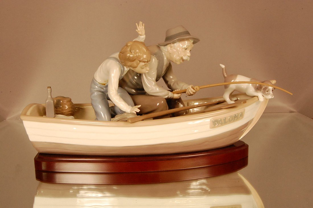 24: Llardo porcelain of man, boy & dog in fishing boat.