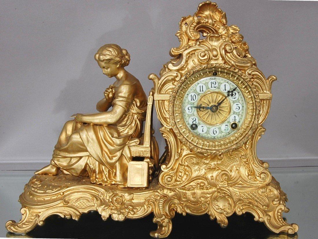 1: Ansonia  Vassar Figural mantel clock.
