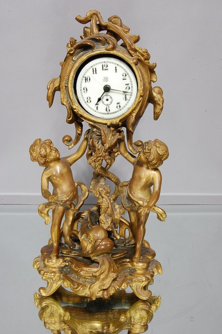 3: French Louis XV style Figural clock.  Spelter statue