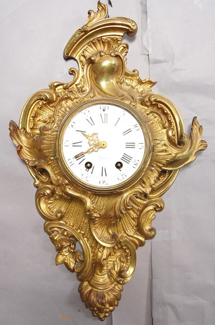 12: French Louis XV style Dore Bronze Cartel Clock
