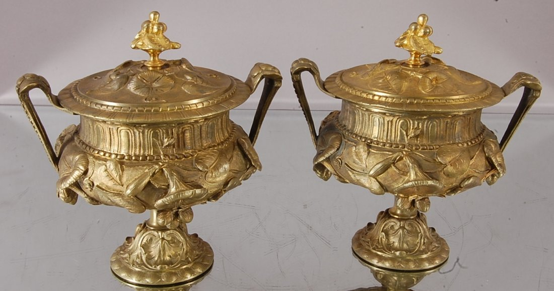 Pair of French Louis XV style Bronze urns with lids.